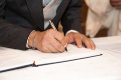 Wedding signature. Groom  write on registration of marriage Stock Image