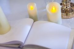 Wedding signing book, blank page. Guest list, with candles and gold candlestick. concept by memory and notebook Stock Images