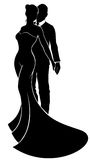 Wedding Silhouette Bride and Groom. A bride and groom silhouette wedding couple, the bride in a bridal dress gown Stock Image