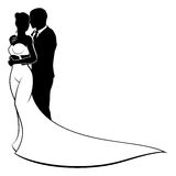Wedding Silhouette Bride and Groom. A bride and groom silhouette wedding couple, in a bridal dress gown Stock Photo