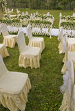 Wedding site. Picture of chairs and decorative flowers on a wedding site Royalty Free Stock Photos