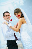 Wedding smile couple with red heart in a hands royalty free stock images