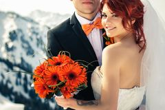 Wedding snowboarders couple just married at mountain winter stock photos
