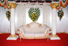 Wedding Sofa. A sofa in a wedding background in a red floor Stock Photo