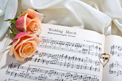 Wedding song. Sheet music of the Wedding March with roses and rings Stock Photos
