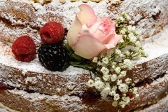 Sponge Cake with fresh berry fruit and flowers. Wedding Sponge Cake with fresh berries flowers Stock Photography