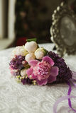 Wedding spring violet bouquet of bride on table Royalty Free Stock Photography