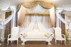 Wedding stage. Cream and gold wedding stage royalty free stock photo