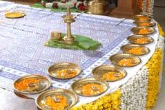 Wedding stage decoaration. A kerala hindu wedding stage decorated with flowers,nila vilakku,brass plates with small lambs Stock Image