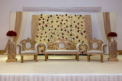 Wedding stage. Gold and red themed indian wedding stage royalty free stock photography