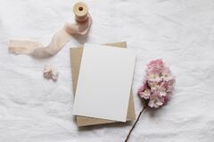 Free Wedding Stationery Mock-up Scene. Blank Vertical Greeting Card, Envelope On Linen Tablecloth Background With Pink Royalty Free Stock Photography - 177310437
