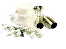 Wedding Still Life. White cake, 2 champagne glasses, white flowers with ribbon royalty free stock image