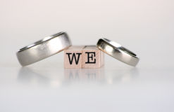 """Wedding still life. Wedding rings sitting on top of wooden stamps saying """"We royalty free stock images"""