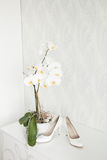 Wedding still life - Bridal bouquet and bride's shoes Stock Photos