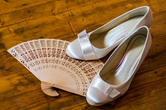 Wedding. Still life - bridal court shoues and fan Stock Photo