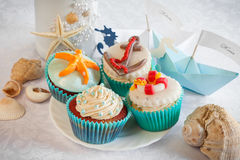 Wedding still life - cupcakes, paper boats and wine Stock Photography
