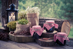 Wedding still life with decoration in rustic style and jars of f Stock Images