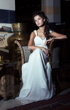 Wedding Style. Aristocratic Bride sitting in White Dress. Restaurant Interior Stock Photo