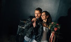 Wedding in the style of rock. Rocker or Biker wedding. Wedding in the style of rock. Guys with stylish leather jackets. It`s a rock`n`roll baby Sweet couple in royalty free stock photography