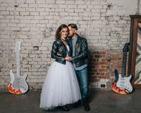 Wedding in the style of rock. Rocker or Biker wedding. Guys with stylish leather jackets. It`s a rock`n`roll baby Royalty Free Stock Photos