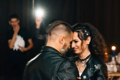 Wedding in the style of rock. Rocker or Biker wedding. Guys with stylish leather jackets. It`s a rock`n`roll baby! A wedding dance Royalty Free Stock Photo