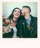 Wedding in the style of rock. Rocker or Biker wedding. Guys with stylish leather jackets. It`s a rock`n`roll baby! The sweet couple are photographed in a stock photography