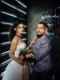 Wedding in the style of rock. Rocker or Biker wedding. Guys with stylish leather jackets. It`s a rock`n`roll baby Sweet couple in a photo studio. Steep stock photography