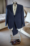 Wedding suit, shirt, trousers, shoes of groom hanging on hanger Stock Photography