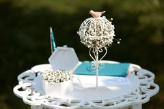 Wedding registration decoration taken outdoor. Wedding summer outdoor registration decoration of the white table with a registration book and wedding rings Stock Photos