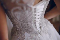 Wedding sun day. Morning brilliant blonde bride dress try on ore Stock Photo