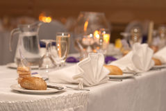 Wedding Table. Set with bread rolls and glasses ready for reception to start Royalty Free Stock Image