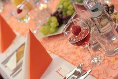 Wedding table. Setting in orange Stock Image