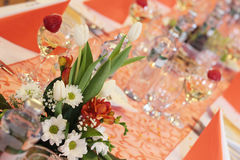 Wedding table. Setting in orange with flowers Royalty Free Stock Image