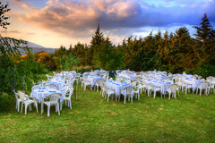Wedding table. With gold sky at sunset time Stock Photos