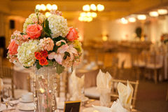 Wedding Table. Decorated wedding table with silverware dishes and flower center piece Stock Image