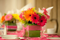 Wedding Table. Decorated wedding table with silverware dishes and flower center piece Stock Photos