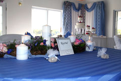 Wedding Table. Reserved table at wedding, with flowers candles and favors Royalty Free Stock Photo