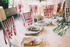 Wedding table appointments. With fork, knives and plates Royalty Free Stock Photo