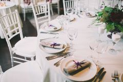 Wedding table appointments. With plates, forks and knives Royalty Free Stock Images