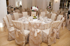 Wedding table arrangement. Table setting at a wedding reception Stock Photography