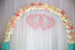 Wedding table, background arch decorated with flowers.  Royalty Free Stock Image