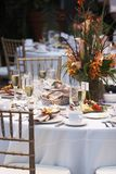 Wedding Table with bouquet of flowers. A wedding table is set for fine dining Royalty Free Stock Photography