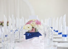 Wedding table with bouquet of flowers Royalty Free Stock Image