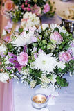 Wedding table with Bouquets with pink roses and chrysanthemums Stock Photos