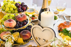 Wedding table with candle and heart-shaped decoration Royalty Free Stock Photo