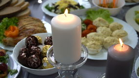 Wedding table with candles for dinner in the restaurant stock video