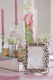 Wedding table with candles, flowers and sign number. Wedding table with the sign number in the background calla flowers close up Royalty Free Stock Photo