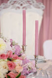 Wedding table with candles, flowers and sign number Royalty Free Stock Photography