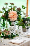 Wedding table centerpiece. A wedding table set for fine dining with a pretty flower centerpiece Stock Photography