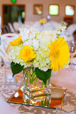 Wedding Table Centerpieces with Flowers. Flowers in glass on the tables for the centerpieces at this indoor wedding reception Royalty Free Stock Photos
